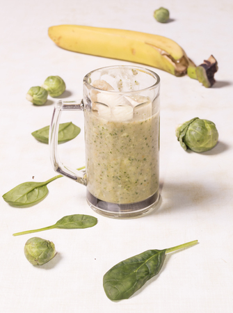 Glass of smoothie with broccoli banana and mint Stock Photo