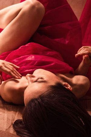 woman lying down in red material Stock Photo - 3413210