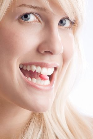 close up of a woman taking pill Stock Photo - 3413216