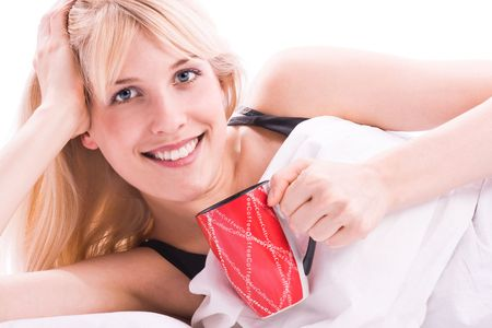 young blond woman drinks coffee in the morning Stock Photo - 3413231