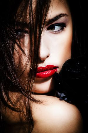 glamour portrait of a beautiful woman with black rose Stock Photo - 4023377