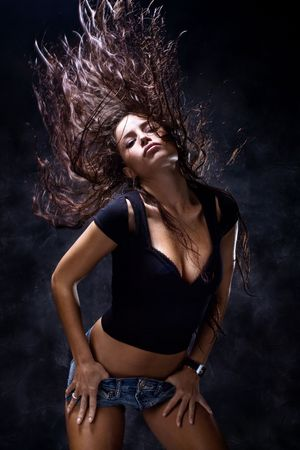 attractive woman dancing, hair flying Stock Photo - 4023385