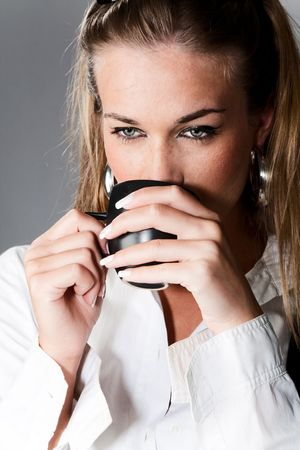 young woman with cup of coffee Stock Photo - 4941899