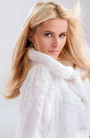 young blond woman in white fur photo