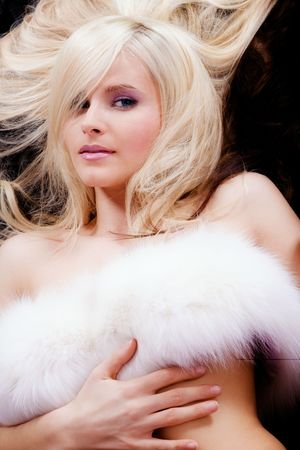 dark blond: sensual blond woman with white fur Stock Photo