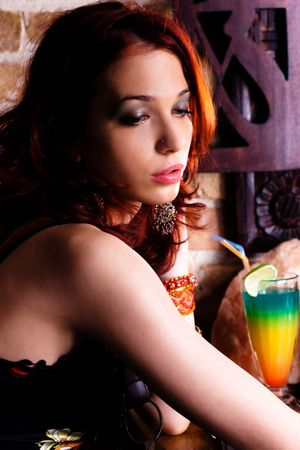red haired woman in bar waiting for someone photo