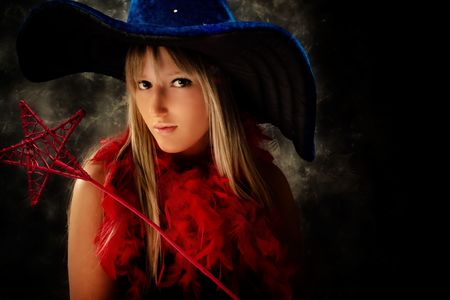 teenage girl wearing wizard costume, studio shot Stock Photo - 4978479