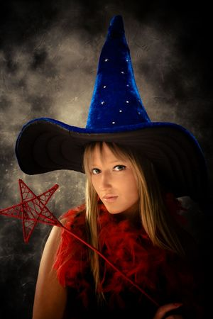 blond teenage girl with wizard hat and wand, studio shot Stock Photo - 4978450