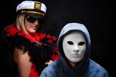 strange couple with fanny masks, studio dark photo