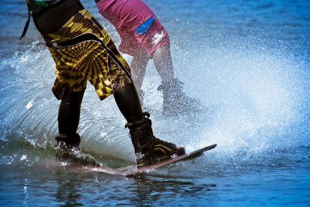 two men skiing on water photo