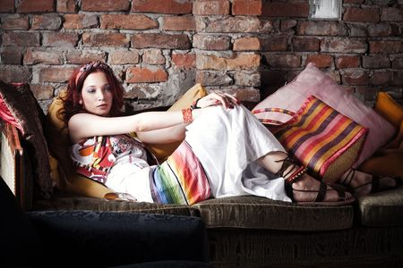 red hair woman in summer clothes resting on sofa Stock Photo - 5017433