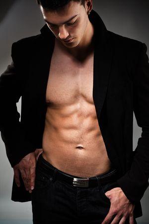 muscular build: young handsome man, studio shot