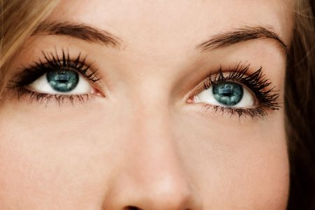 eye lashes: close up of a woman with blue eyes Stock Photo