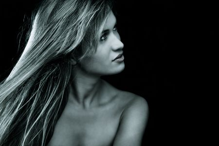 blond woman beauty portrait, studio dark background Stock Photo - 5526866