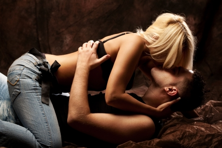 sex activity: young couple in love, studio shot Stock Photo