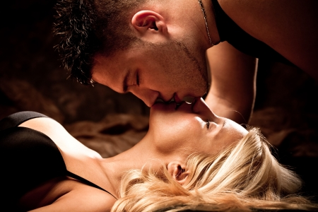young passion lovers kissing, studio shot photo