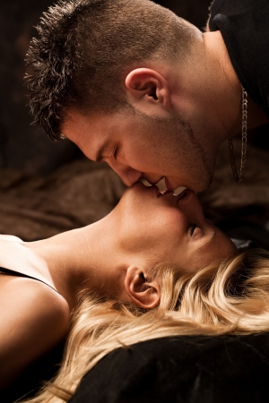 young passion lovers kissing, studio shot Stock Photo - 5595599