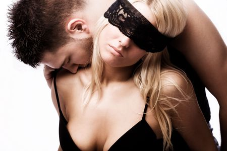 young masked couple in love, studio shot on white Stock Photo - 5595604