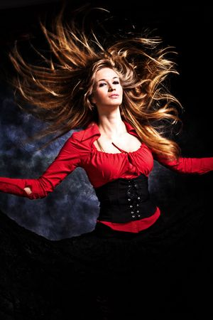 flying hair: blond woman with long  flying hair