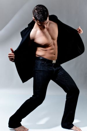 handsome young man in dancing position, studio shot photo