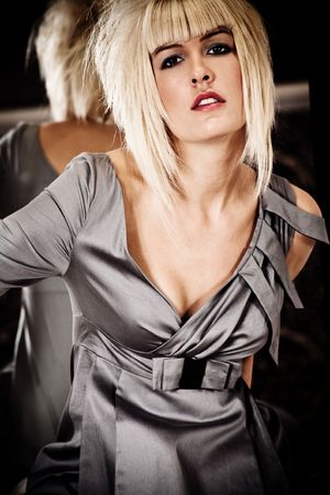 blond woman with modern hairstyle wearing elegant dress, indoor shot Stock Photo - 5877168