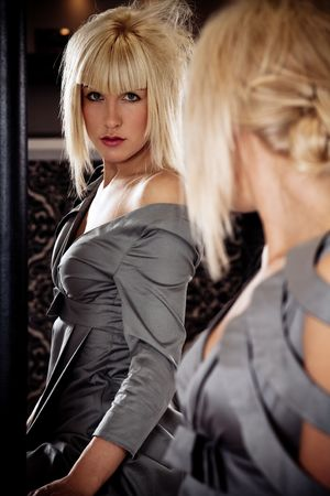 blond fashion model in front mirror, indoor shot Stock Photo - 5877171