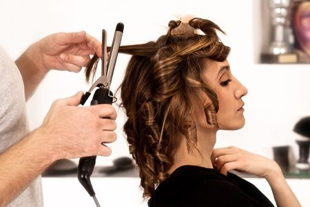 stylists: young woman at hairdresser, indoor shot