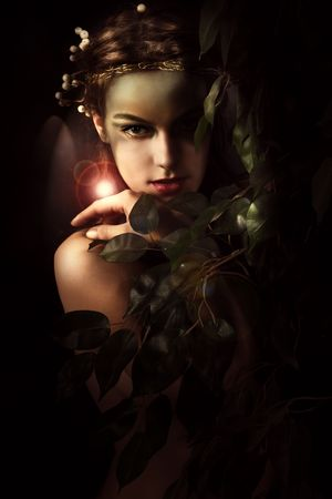 young woman styled as a forest nymph, studio shot photo