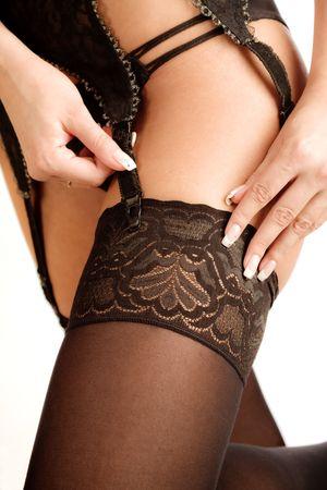 beautiful female legs in black stockings, studio shot photo