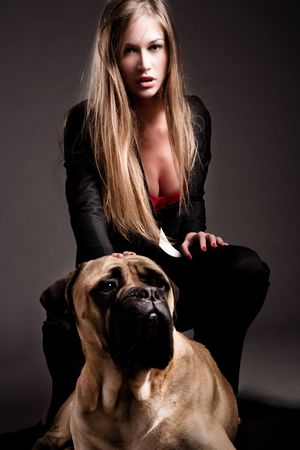 young fellow: attractive blond woman with guard dog studio shot Stock Photo