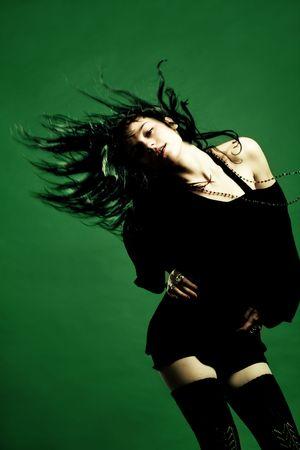 pleasures: young woman dancing, studio shot Stock Photo
