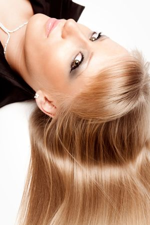 young blond woman hair portrait studio white photo