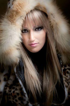 beautiful blond woman in fur, studio shot photo
