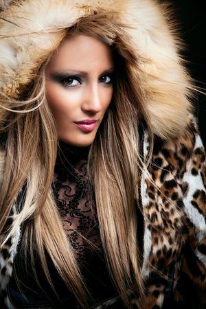 beautiful young blond woman portrait  in fur, studio shot photo