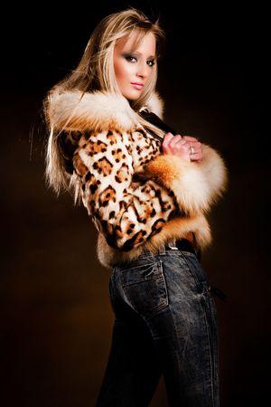 blond woman in fur, studio shot photo