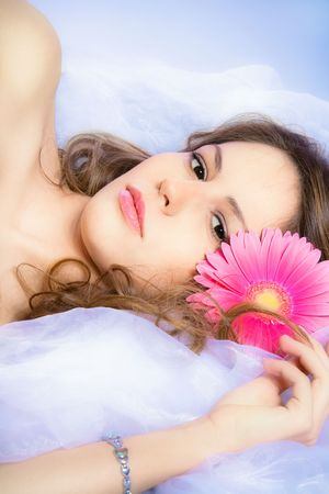 beautiful young brunette woman with pink flower, studio shot Stock Photo - 6223958