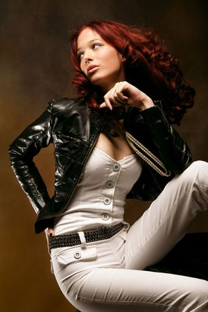 attractive red hair woman fashion portrait, studio shot photo