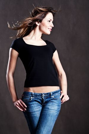 chearful: smiling young woman in jeans and t shirt, studioshot