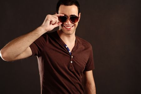 smiling handsome young man portrait with sunglasses, studio shot Stock Photo - 6284597