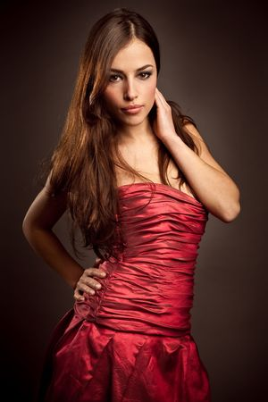 young beautiful woman in red dress photo