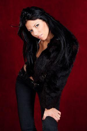 pretty young woman posing, studio shot photo