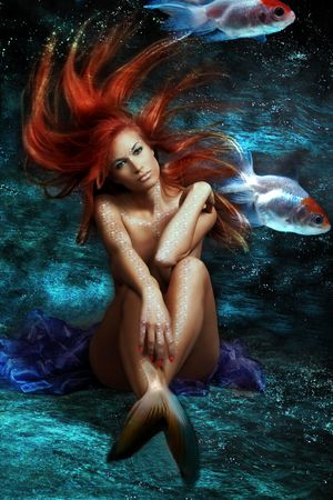 mythology being, mermaid with red floating hair photo
