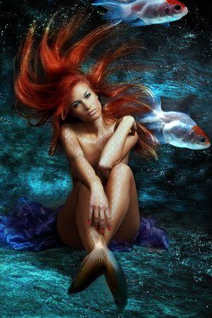 beautiful mermaid: mythology being, mermaid with red floating hair