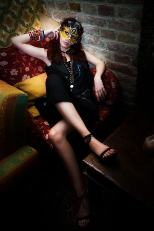red hair woman wearing mask in night club Stock Photo - 6452298