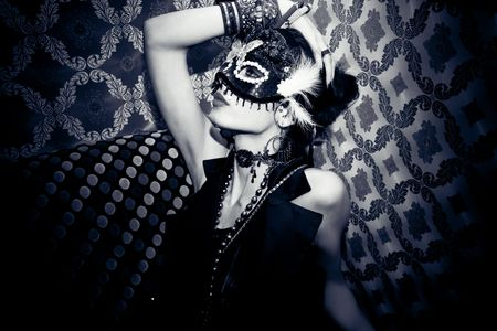 funfair: beautiful woman with mask in night club
