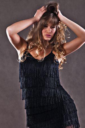 woman dancing, hands in hair Stock Photo - 6726558