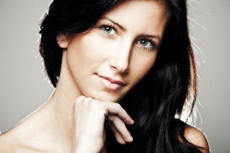 green eyes black hair young woman beauty portrait, studio shot Stock Photo - 6726565