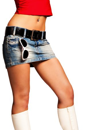 tight jeans: tanned woman body in jeans skirt white boots and sunglasses, studio white Stock Photo