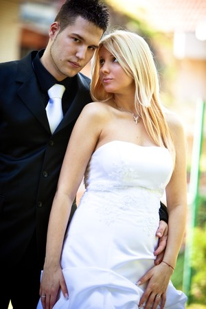 young bride and groom outdoor shot photo