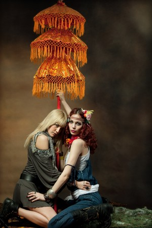two fashionable woman with parasol photo
